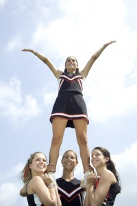 Cheerleaders Doing Routine --- Image by © Royalty-Free/Corbis